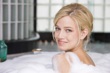 Woman taking a bubble bath