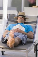 Man sleeping on a lounge chair