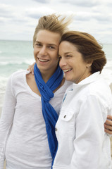Teenage boy with his grandmother on the beach