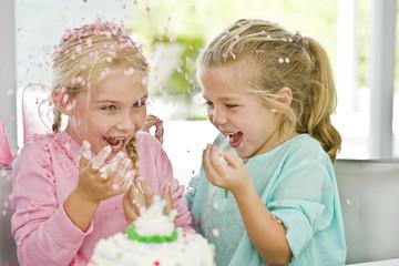 Two girls enjoying a birthday party