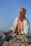 Handsome mature man adventurer posing outdoors poster