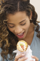 Close-up of a girl eating a sandwich