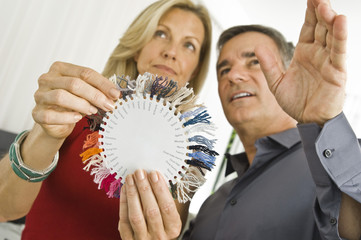 Couple choosing color from a color swatch
