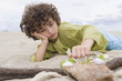 Boy playing with sand on the beach