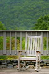 A rocking chair on a deck