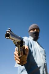 Hooded man 44 magnum handgun
