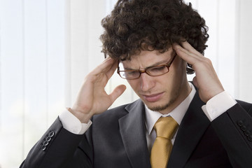Young businessman having a headache