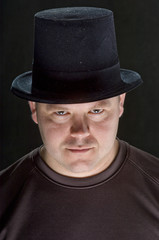 Man in Hat Staring Intently