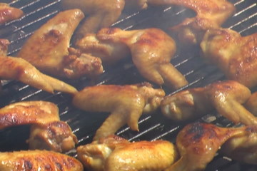 Sizzling barbecue chicken on the grill - 4:3 anamorph