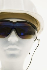 Mannequin wearing safety glasses and a helmet