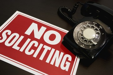 No soliciting sign with a telephone