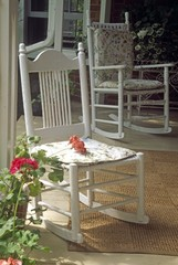 Rocking chairs on country porch..