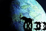 Elephant silhouettes in front of a globe