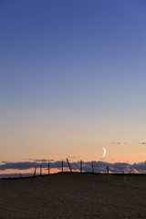 Moonrise over fenceline..