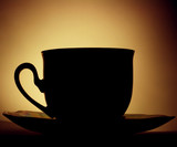 Coffee cup in backlight poster