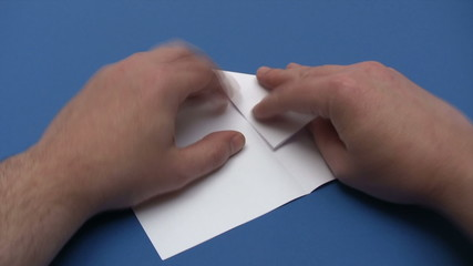 Folding a Paper Plane - Time Lapse