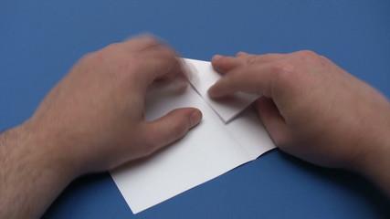 Folding a Paper Plane - Time Lapse