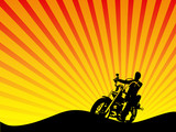 Motorcycle Rider Silhouette Against Sunset Background
