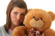 Beautiful teenager holding a teddy bear