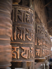 Prayer wheels in buddhist temple