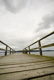 British Columbia, Canada; Wooden dock with a view into land poster