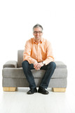 Fototapety Man sitting on couch