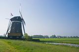 Dutch watermill in polder in spring