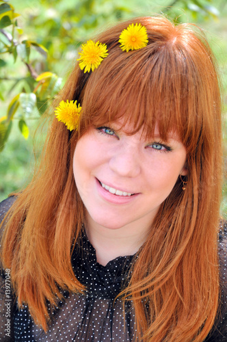 Beauty Redheaded Girl With Dandelions In Her Hair