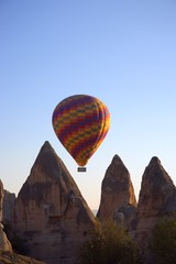 Hot air balloon flying over Goreme valley, Cappadocia, Anatolia, Turkey..
