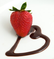 single strawberry on a chocolate heart