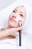beautician applying cosmetic mask poster