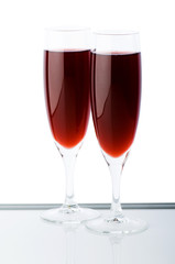Two wine glasses on the white background