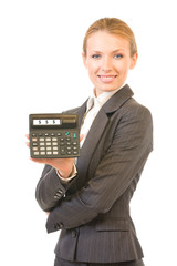 Young happy businesswoman with calculator, isolated