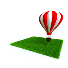bright baloon and lawn from a green bright grass