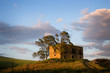 trees and large farmhouse in country to twilight