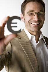 Mann mit Eurozeichen