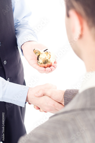Business men with piggybank isolated on white