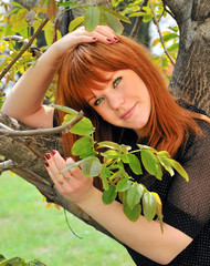 Beauty Redheaded Gir unger the tree