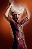 Cute blonde in vampire look poster