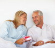 Romantic mature couple giving anniversary gift