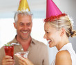 Happy mature couple enjoying a birthday party