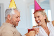 Cheers: Elderly couple at a birthday celebration