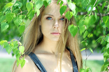 Russian beauty - the happy girl at a white birch