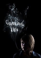 "young women smokes in the smoke appears ""Smoking Kills"""