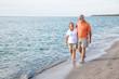 Leinwandbild Motiv Seniors Walking on the Beach