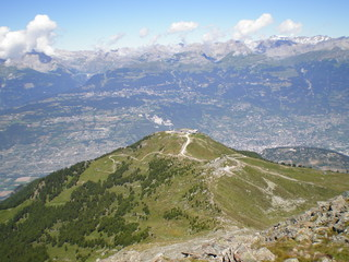 view of the alps and of a valley from a swiss mountain