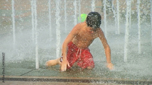 Boy Playing in Fountain
