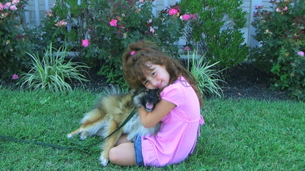 Girl Hugging Dog and Smiling