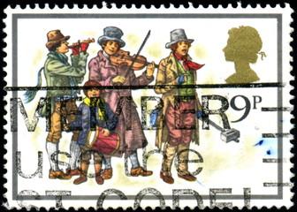 UK. Musiciens des rues. Timbre postal oblitéré.