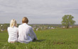 Couple sitting on a green meadow